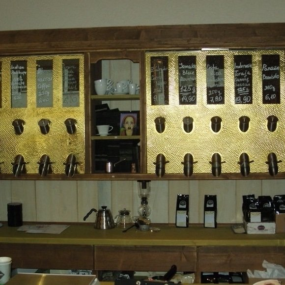 Coffee dispensers on cafe wall